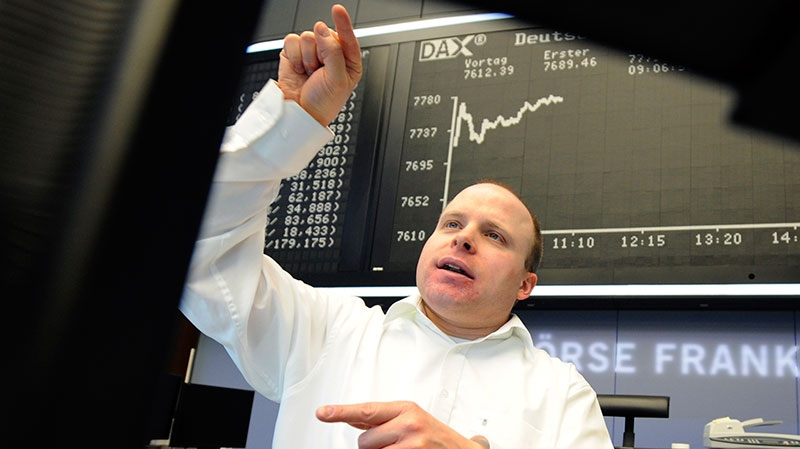 A broker views his monitor at the Stock Exchange in Frankfurt, Germany, Wednesday, Jan. 2, 2013. (dpa, Arne Dedert)
