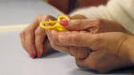 A physical therapist guides a dementia patient through a puzzle at a care centre in the Bronx borough of New York. (AP / Jim Fitzgerald)