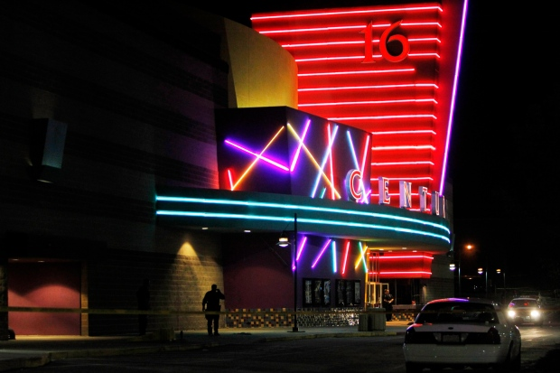 Police are positioned outside the Century 16 movie theatre at the scene of a mass shooting that left 12 dead and dozens wounded, in Aurora, Colo., in July 2012. (AP / Ed Andrieski)