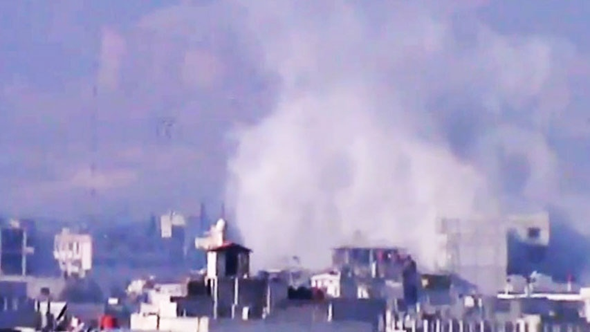 Smoke rises from buildings due to heavy shelling in Damascus countryside, Syria, on Wednesday, Jan. 2, 2013. (Shaam News Network via AP video)