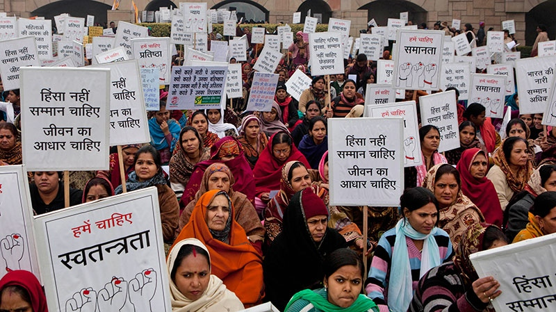 Indian women carry placards and banners as they offer prayers for a gang rape victim, at Mahatma Gandhi memorial, in New Delhi, India, Wednesday, Jan. 2, 2013. (AP / Dar Yasin)