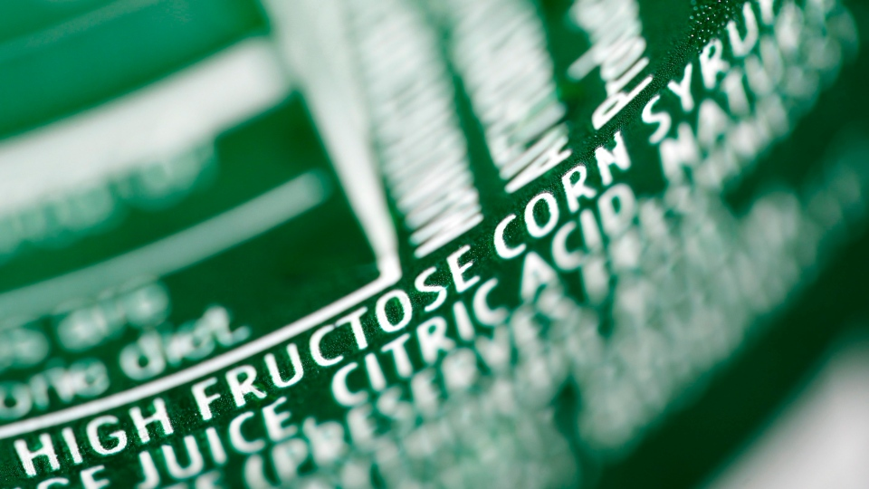 High fructose corn syrup is listed as an ingredient on a can of soda, as shown in this 2011 file photo. (AP Photo / Matt Rourke)