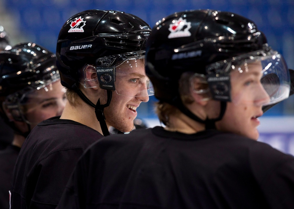 Team Canada defenceman Dougie Hamilton, centre, laughs as he watches a drill during practice at the IIHF World Junior Championships in Ufa, Russia on Dec. 29, 2012. (Nathan Denette / THE CANADIAN PRESS)