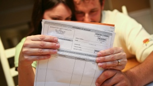 A couple sits down to look over their monthly bills in this 2009 file photo. (AP / Jenni Girtman)