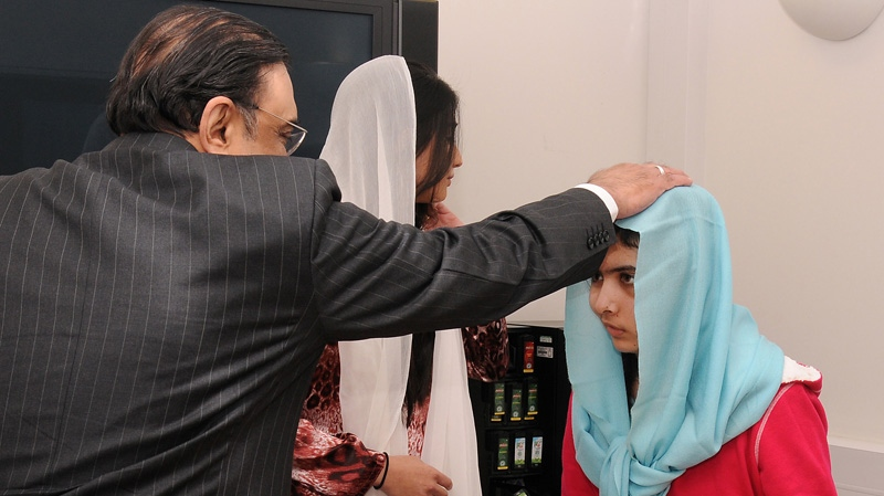 Pakistan's President Asif Ali Zardari and his daughter Asifa Bhutto, meet with Malala Yousufzai, where she is undergoing treatment for injuries sustained when a Taliban gunman opened fire on her and her friends outside the Khushal School for Girls in Mingora, Swat Valley, Pakistan, at the Queen Elizabeth Hospital in Birmingham, England, Dec. 8, 2012. (AP / Queen Elizabeth Hospital Birmingham)