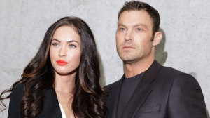 Megan Fox poses with her husband Brian Austin Green after watching the presentation of the Emporio Armani Spring-Summer 2011 fashion collection, during the fashion week in Milan, Italy, Saturday, Sept. 25, 2010. (AP / Luca Bruno)