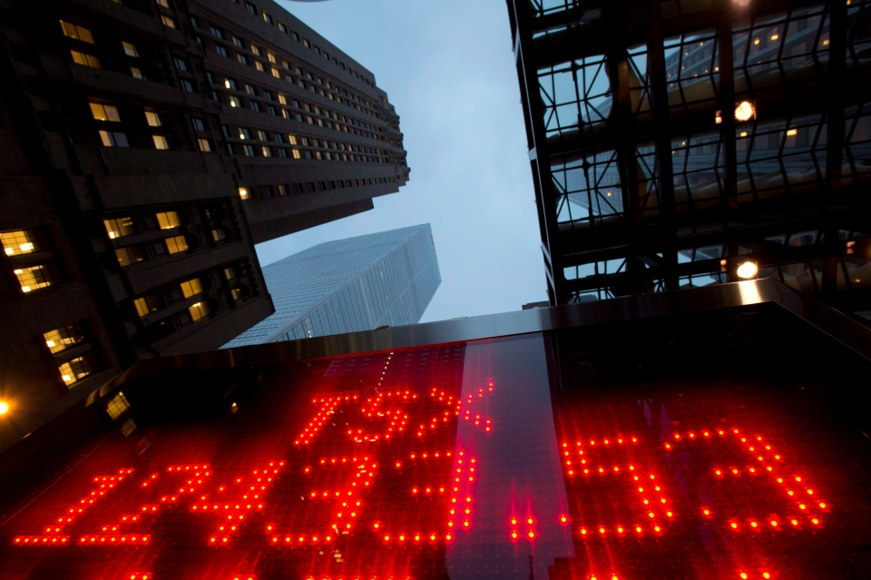 A tote board displays the closing figure for the TSX for the year in Toronto, Monday, Dec. 31, 2012. (Frank Gunn / THE CANADIAN PRESS)
