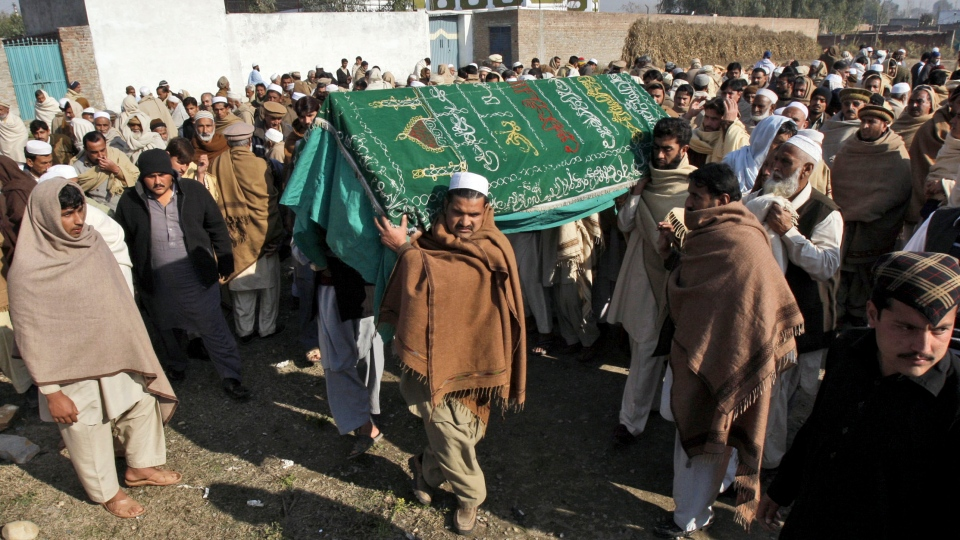 Pakistani relatives and mourners carry the body of aid worker Lubna Mahmoud, 26, who was killed on Tuesday, by gunmen, during her funeral procession in Swabi, Pakistan, Wednesday, Jan. 2, 2013. (AP / Mohammad Sajjad)