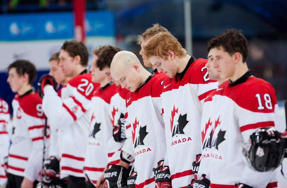 Team Canada players hang their heads after being defeated by Team USA during third period semi-final IIHF World Junior Championships hockey action in Ufa, Russia on Thursday, Jan. 3, 2013. (Nathan Denette / THE CANADIAN PRESS)