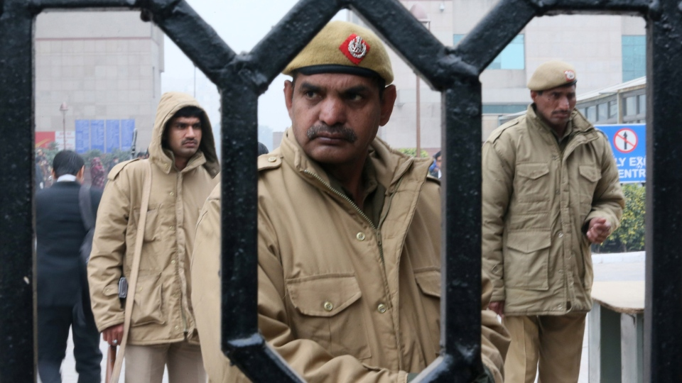 Indian policemen stand guard at the District Court complex where a new fast-track court was inaugurated Wednesday to deal specifically with crimes against women, in New Delhi, India, Thursday, Jan. 3, 2013. (AP / Manish Swarup)