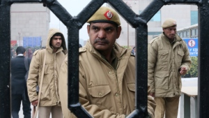 Indian policemen stand guard at the District Court complex in New Delhi, India on Thursday, Jan. 3, 2013. (AP / Manish Swarup)