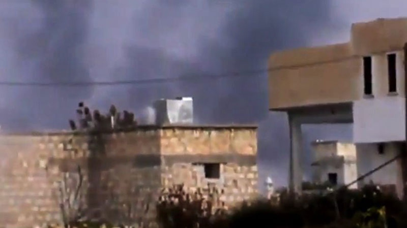 Smoke rises from buildings in Taftanaz village in northern Syria, on Wednesday, Jan. 2, 2013. (Shaam News Network via AP video)