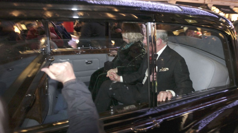 A protester bangs on the window of the car carrying Britain's Prince Charles and Camilla, Duchess of Cornwall, in London, Thursday, Dec. 9, 2010. (AP / Matt Dunham)