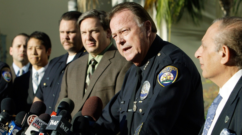 Beverly Hills, Calif., Police Chief Dave Snowden, second from right, with Det. Sgt. Mike Publicker, third from right, and Mayor Jimmy Delshad, right, amond city officials talking to reporters about the murder of publicist Ronni Chasen, at a news conference at police headquarters Wednesday, Dec. 8, 2010. (AP / Reed Saxon)