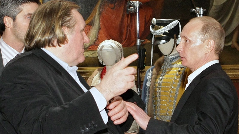 Russian Prime Minister Vladimir Putin, right, and French actor Gerard Depardieu talk during their visit to the Russian Museum in St. Petersburg, Russia, Saturday, Dec. 11, 2010. (RIA Novosti, Alexei Nikolsky)