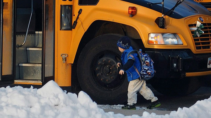 A child boards a bus on the first day of classes after the holiday break, in Newtown, Conn., Wednesday, Jan. 2, 2013. (AP/ Jessica Hill)
