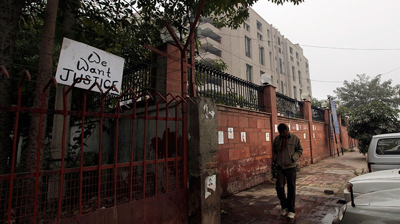 A placard hangs on a fence of the District Court complex where a new fast-track court was inaugurated Wednesday to deal specifically with crimes against women in New Delhi, India, Thursday, Jan. 3, 2013. (AP / Manish Swarup)