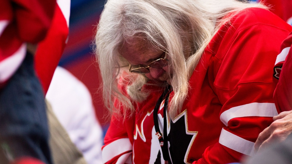 Canada fans hang their heads as Canada plays against Team USA during third period semi-final IIHF World Junior Championships hockey action in Ufa, Russia on Thursday, Jan. 3, 2013. (Nathan Denette / THE CANADIAN PRESS)