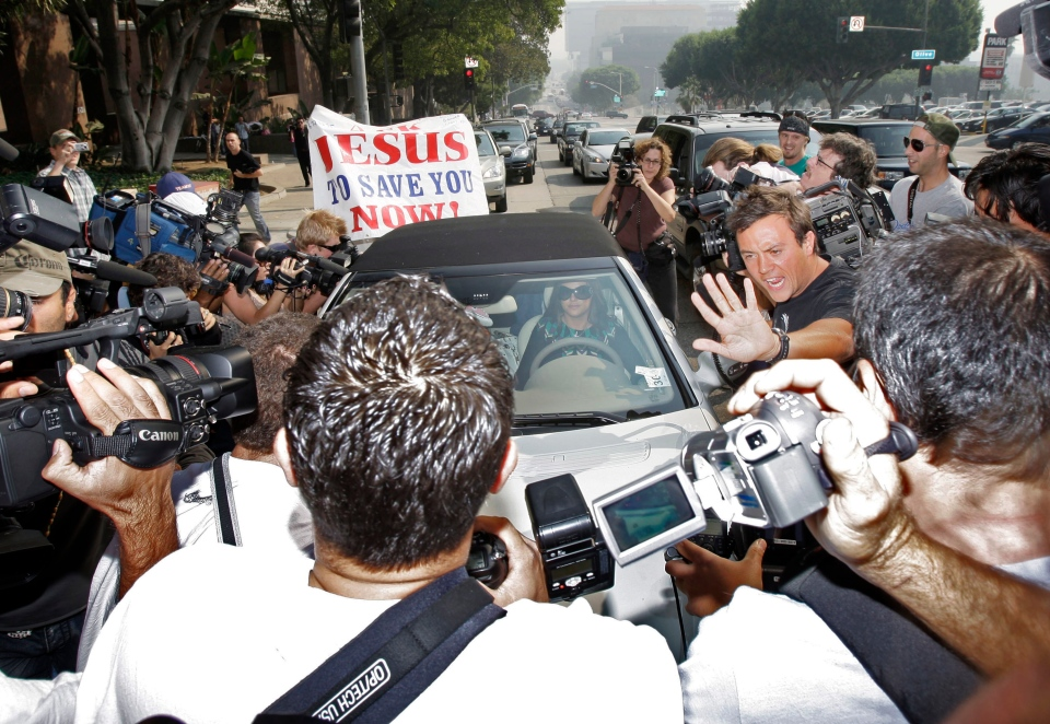 Britney Spears is surrounded by paparazzi as she arrives at a court hearing in Los Angeles, Oct. 26, 2007.  (AP / Kevork Djansezian)