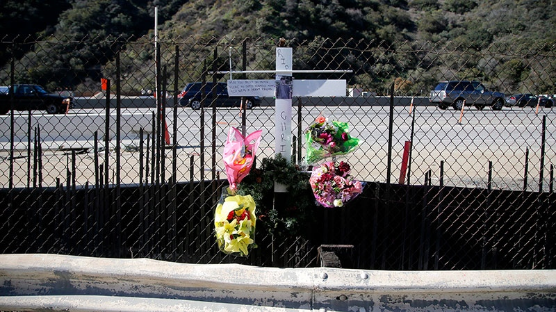 A roadside memorial for a paparazzo, who was killed by a car while darting across a street after taking pictures of Justin Bieber's Ferrari, is seen near the 405 Freeway in Los Angeles, Wednesday, Jan. 2, 2013. (AP / Jae C. Hong)