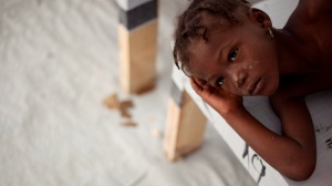 Nadia Pier, a girl suffering cholera symptoms, rests as she is treated at a cholera clinic in Port-au-Prince, Haiti, Monday, Dec.6, 2010. (AP / Guillermo Arias)