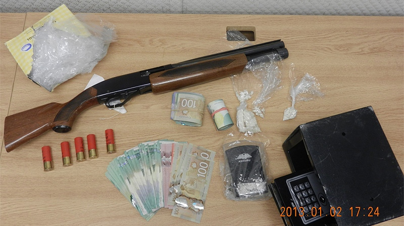 Two have been charged after Spruce Grove/Stony Plain RCMP executed a search warrant in Stony Plain on Dec. 28, and found illicit drugs and firearms, some of which are pictured here. Supplied.