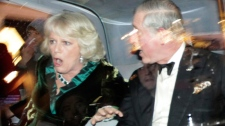 Britain's Prince Charles and Camilla, Duchess of Cornwall, react as their car is attacked by angry protesters in London, Thursday, Dec. 9, 2010. (AP / Matt Dunham)