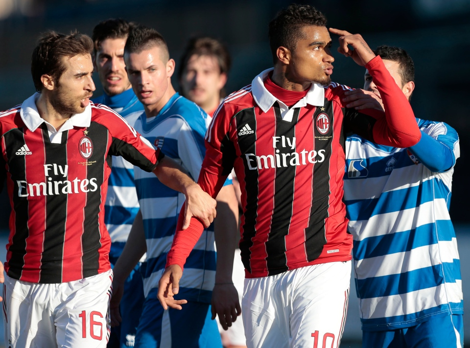 AC Milan Ghana midfielder Kevin-Prince Boateng, right, is flanked by his teammate Mathieu Flamini as he gestures towards the crowd in Busto Arsizio, near Milan, Italy, Thursday, Jan. 3, 2012. (AP / Emilio Andreoli)