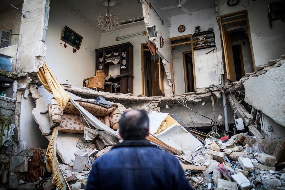 A civilian looks at a destroyed home in Aleppo, Syria, Thursday, Jan. 3, 2013. (AP / Andoni Lubaki)