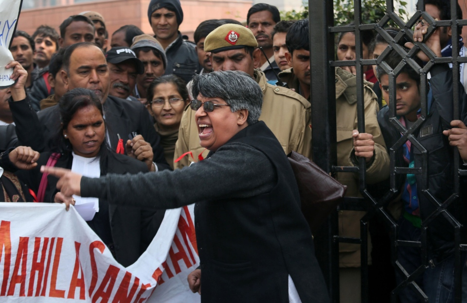 An Indian woman lawyer shouts slogans against police and the government outside the District Court complex where a new fast-track court was inaugurated Wednesday to deal specifically with crimes against women, in New Delhi, India, Thursday, Jan. 3, 2013. (AP / Manish Swarup)