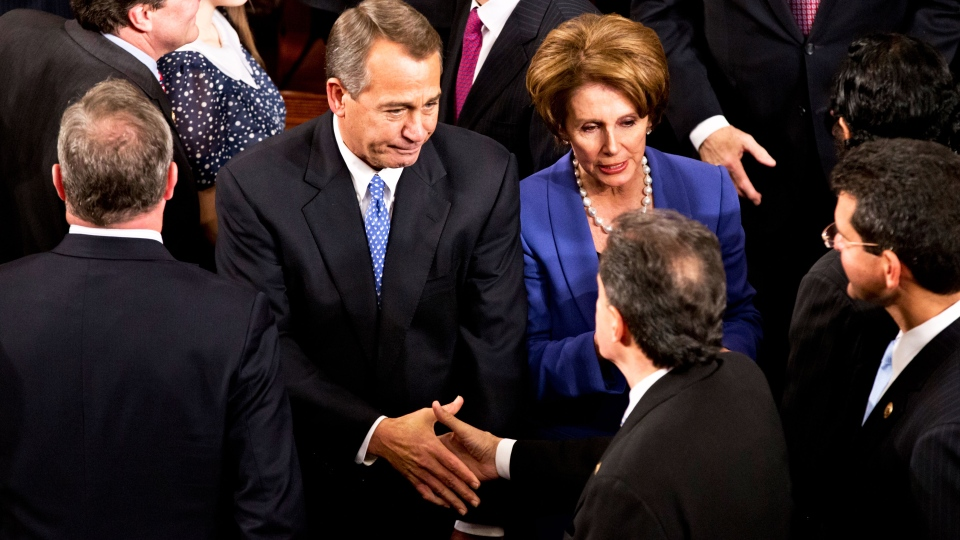 House Speaker John Boehner of Ohio enters the House of Representatives chamber on Capitol Hill in Washington, Thursday, Jan. 3, 2013, after surviving a roll call vote in the newly convened 113th Congress. He is escorted by House Majority Leader Eric Cantor of Va., and House Minority Leader Nancy Pelosi of Calif. (AP / J. Scott Applewhite)