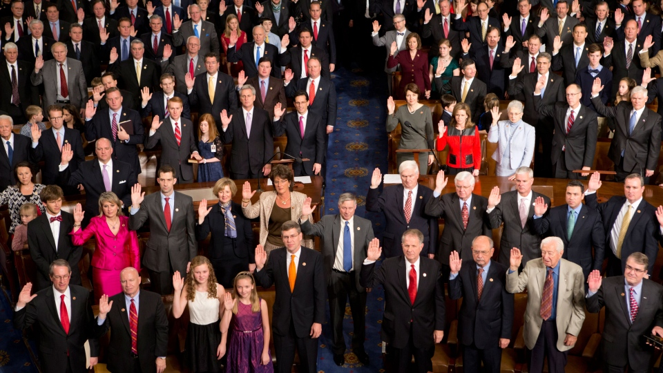 Members of the 113th Congress, many accompanied by family members, take the oath of office in the House of Representatives chamber on Capitol Hill in Washington, Thursday, Jan. 3, 2013. (AP / J. Scott Applewhite)