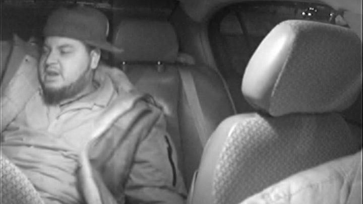 Taxi's internal camera snaps picture of suspect described as a male, darker complexion, 5 feet 7 inches (170 centimeters), medium build, chubby, beard, wearing baggy pants and dark jacket with no accent. (Ottawa Police Service)