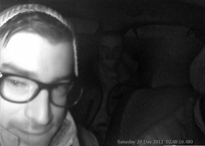 Taxi's internal camera snaps photo of suspect described as a male, possibly Lebanese or Costa Rican, 5 feet 8 inches (173 centimeters), black glasses, no accent and possibly wearing a black jacket. (Ottawa Police Service)