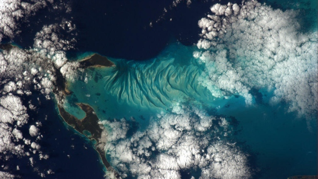 """<a href=""""https://twitter.com/cmdr_hadfield"""" target=""""_blank"""">Chris Hadfield: </a>&#39;The beauty of the Bahamas is surreal; every blue that exists. This photo was taken on New Year&#39;s Day from the Space Station.&#39;"""