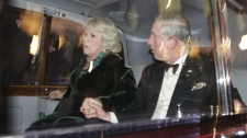 Prince Charles and Camilla, Duchess of Cornwall react as their car is attacked, in London, Thursday, Dec. 9, 2010. (AP / Matt Dunham)