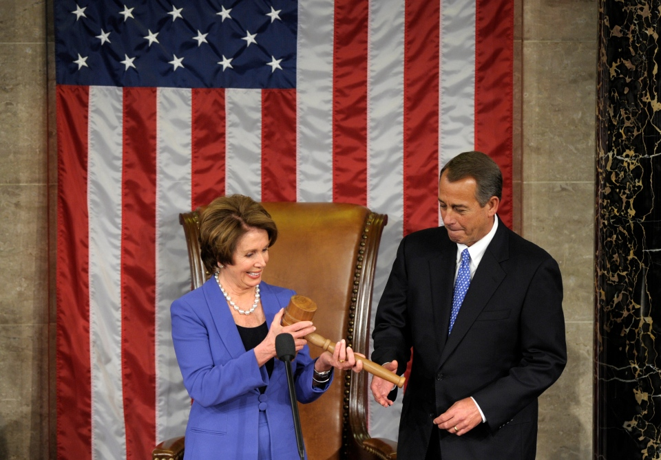 House Minority Leader Nancy Pelosi of Calif. passes the gavel to House Speaker John Boehner of Ohio, who was re-elected as House Speaker of the 113th Congress, on Capitol Hill in Washington, Thursday, Jan. 3, 2013. (AP / Susan Walsh)