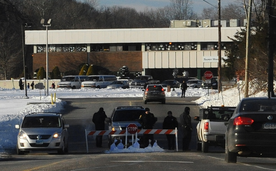 A police road block is at the entrance to the new Sandy Hook Elementary School on the first day of classes in Monroe, Conn., Thursday, Jan. 3, 2013. (AP / Jessica Hill)