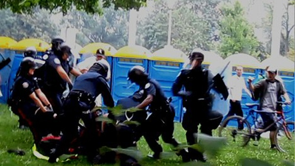 Video images released on Dec. 7, 2010 show the arrest of Adam Nobody during a G20 summit demonstration on June 26, 2010.