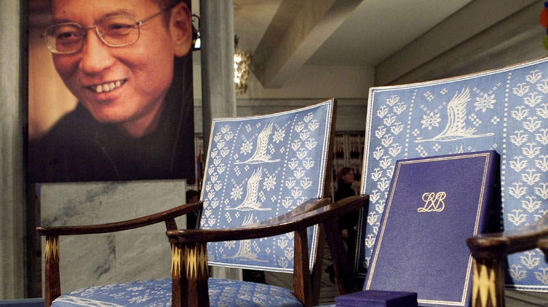 The empty chair, diploma and medal that should have been awarded to this year's Nobel Peace Prize winner Liu Xiaobo, photo at left, in seen in the City Hall in Olso, Norway on Friday Dec. 10, 2010. (AP / Scanpix - Heiko Junge)