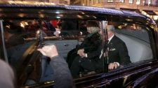 A protester bangs on the window of the car carrying Prince Charles and Camilla, Duchess of Cornwall, in London, Thursday, Dec. 9, 2010.(AP / Matt Dunham)