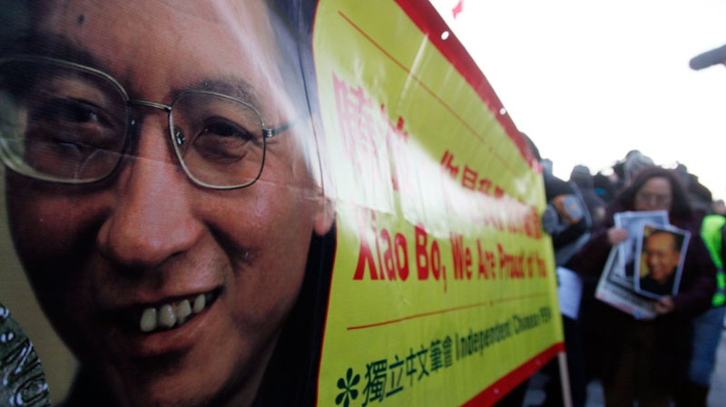 Protesters gather to demand the freedom of Nobel peace laureate Liu Xiaobo Thursday Dec. 9, 2010 outside te Chinese Embassy in Oslo, Norway. (AP / John McConnico)