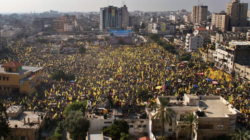 Tens of thousands of Palestinians marched Friday carrying yellow banners of Palestinian President Mahmoud Abbas' Fatah party during celebrations marking the 48th anniversary of the Fatah movement in Gaza City, Friday, Jan. 4, 2013. (AP / Adel Hana)
