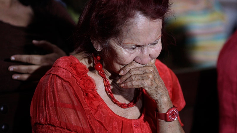 A woman reacts as people gather to pray for Venezuela's President Hugo Chavez at a church in Caracas, Venezuela, Monday, Dec. 31, 2012. (AP / Ariana Cubillos)