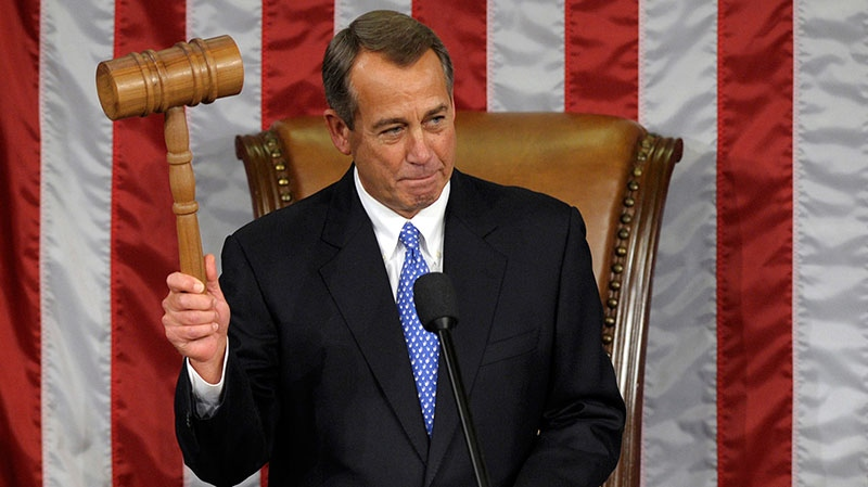 U.S. House Speaker John Boehner of Ohio holds up a gavel  after being re-elected House Speaker as the 113th Congress began, in the House chamber on Capitol Hill in Washington, Thursday, Jan. 3, 2013. (AP / Susan Walsh)