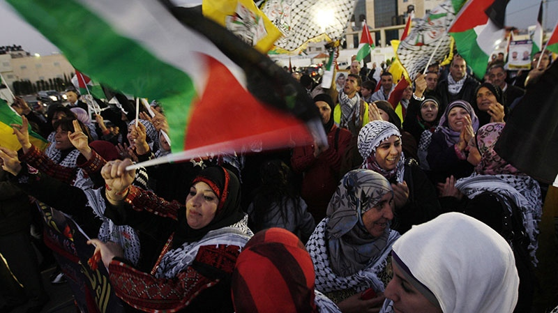 Palestinians celebrate the 48th anniversary of the Fatah movement in the West Bank city of Ramallah, Monday, Dec. 31, 2012. (AP / Majdi Mohammed)