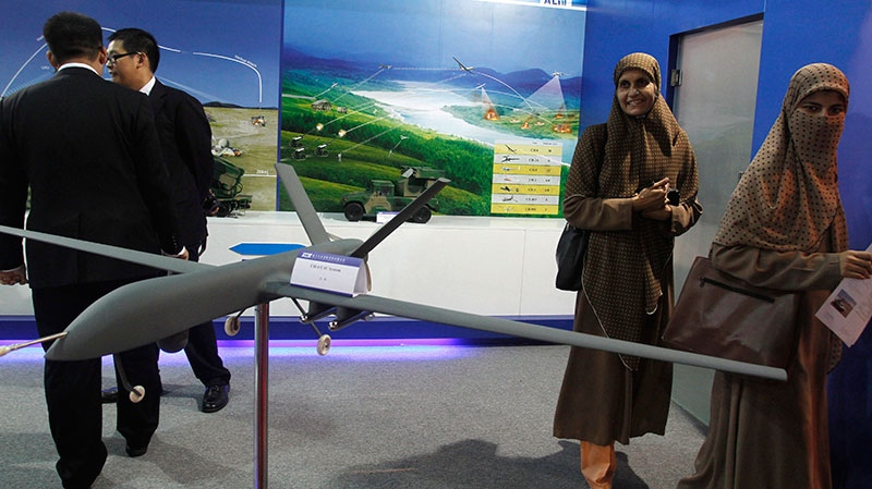Visitors look at Pakistan-made unmanned aircraft at defense exhibition in Karachi, Pakistan, Thursday, Nov. 15, 2012. (AP / Shakil Adil)
