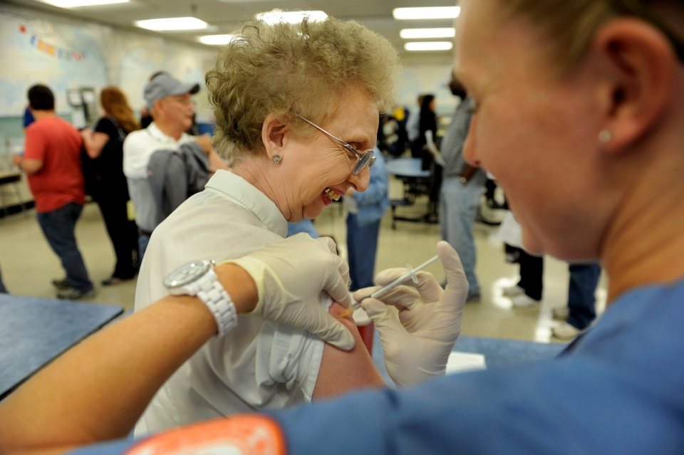 Linda Howard gets her flu shot from nursing student Elizabeth Wallace at the annual Free Flu Shot Saturday at Farragut Intermediate School in Knoxville, Tenn., on Saturday, Oct. 27, 2012. (AP / Knoxville News Sentinel, Michael Patrick)