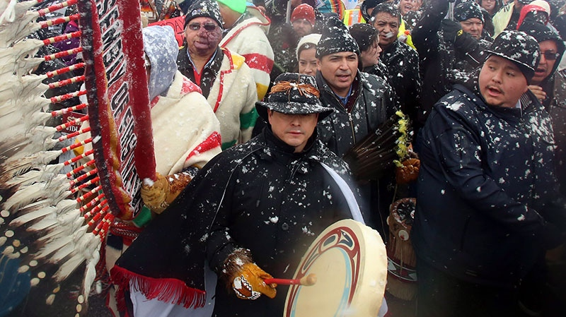 National Chief of the Assembly of First Nations Shawn Atleo, centre, drums as he takes part in a protest on Parliament Hill in Ottawa on Friday, December 21, 2012. (Fred Chartrand / THE CANADIAN PRESS)