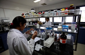 Indian scientists work inside a laboratory of the Research and Development Centre of Natco Pharma Ltd. in Hyderabad, India, March 13, 2012. (AP / Mahesh Kumar A.)